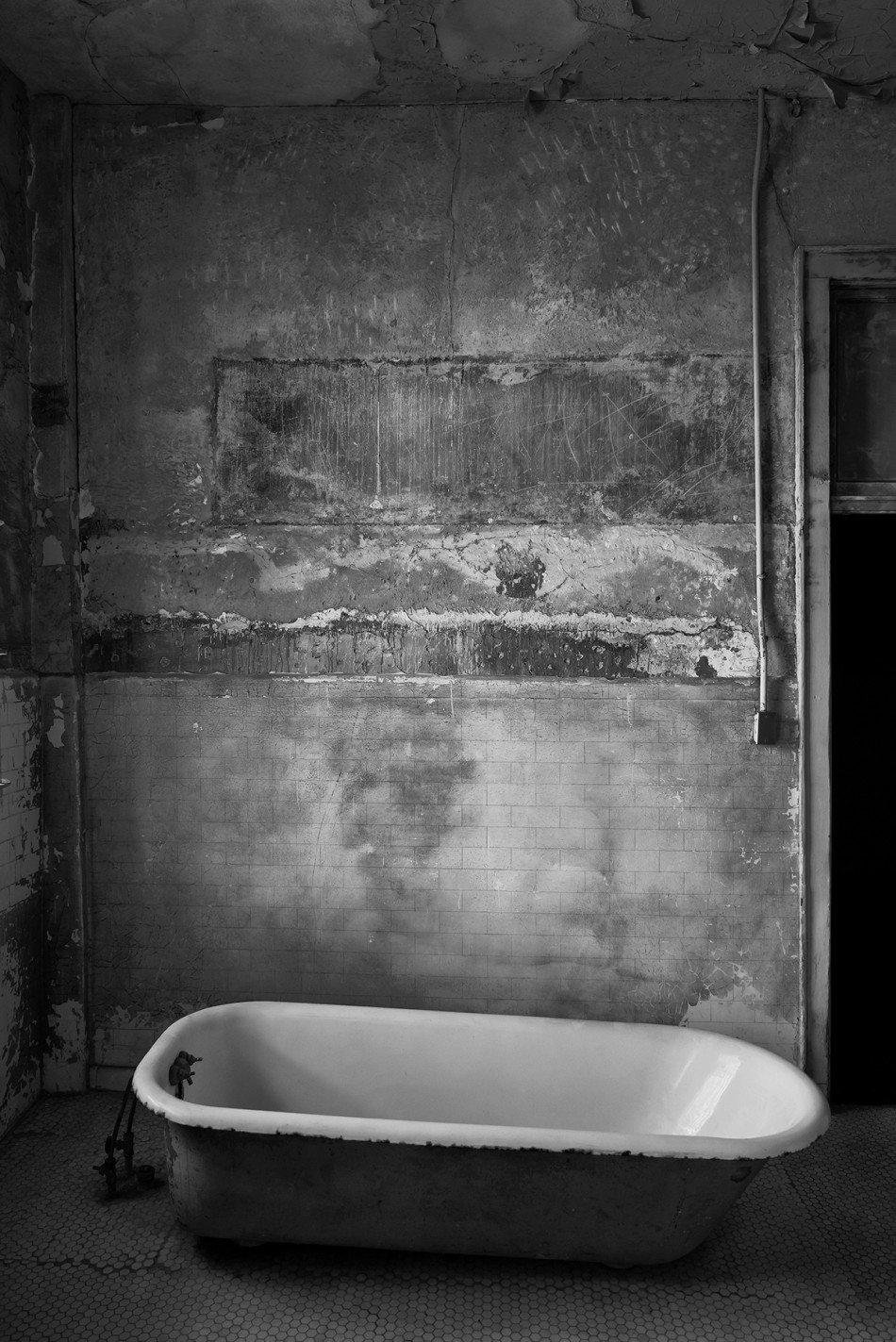 black and white image of a bath in the hydro-therapy room of Alcatraz Prison